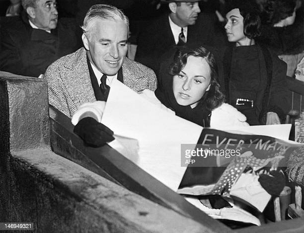 British actor Charlie Chaplin and American actress Paulette Goddard attend a production of 'Everyman' in the Hollywood Bowl on September 13 1936...