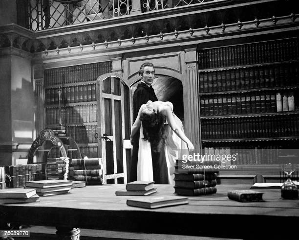 British actor Christopher Lee carries actress Valerie Gaunt from the library in a scene from the Hammer classic 'Dracula' aka 'The Horror of Dracula'...