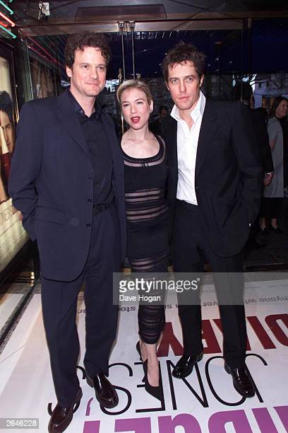 """British actor Colin Firth, American actress Renee Zellweger and British actor Hugh Grant arrive at the premiere of the film """"Bridget Jones' Diary"""" at..."""