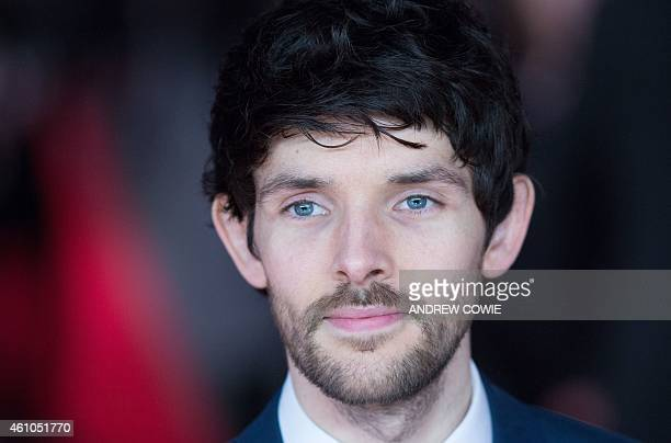 British actor Colin Morgan poses for photographers on the red carpet as he arrives for the Premiere of 'Testament of Youth' in central London on...