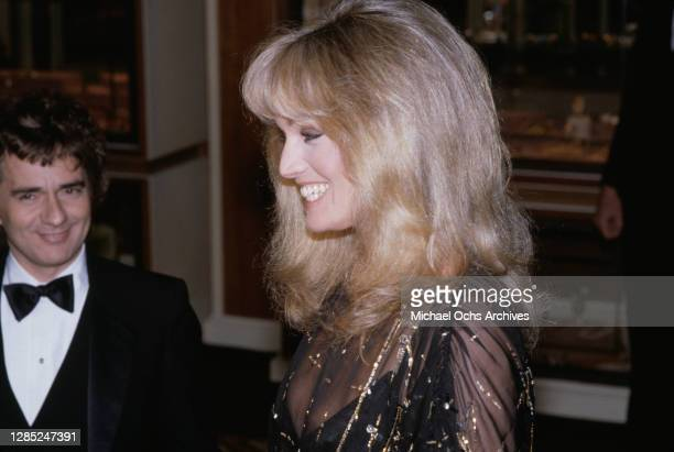 British actor, comedian and pianist Dudley Moore and American actress and singer Susan Anton attend the 40th Annual Golden Globe Awards, held at the...