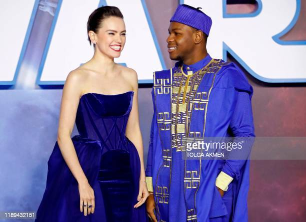 British actor Daisy Ridley and British actor John Boyega pose on the red carpet upon arrival for the European film premiere of Star Wars The Rise of...