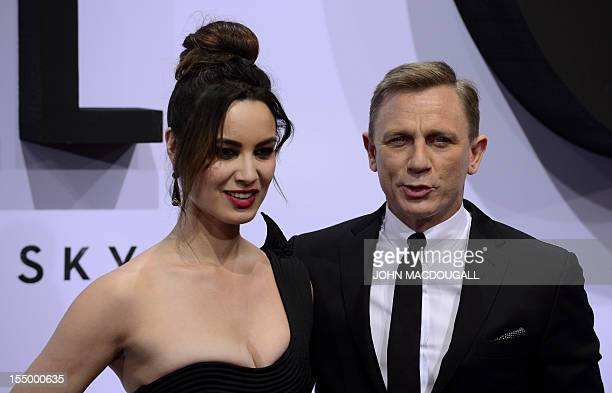 British actor Daniel Craig and French actress Berenice Marlohe pose as they arrive for the German premiere of the new James Bond movie 'Skyfall' in...