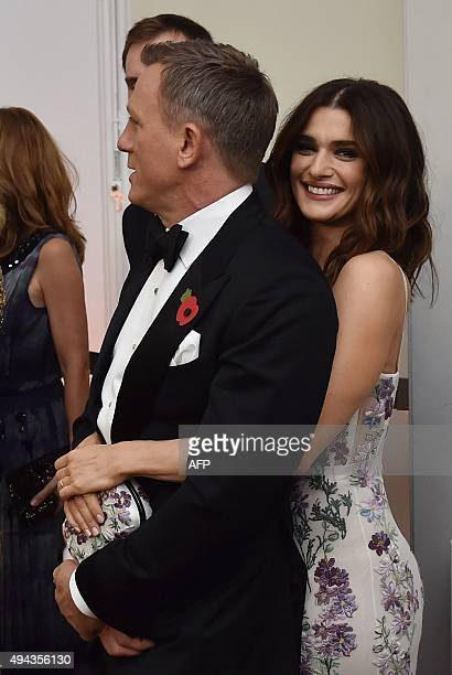 British actor Daniel Craig and his partner Rachel Weisz stand before the world premiere of the new James Bond film 'Spectre' at the Royal Albert Hall...