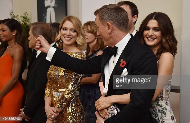 British actor Daniel Craig and his partner Rachel Weisz stand with cast members before the world premiere of the new James Bond film 'Spectre' at the...