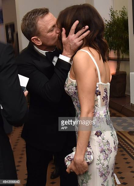 British actor Daniel Craig kisses his wife Rachel Weisz before the world premiere of the new James Bond film 'Spectre' at the Royal Albert Hall in...