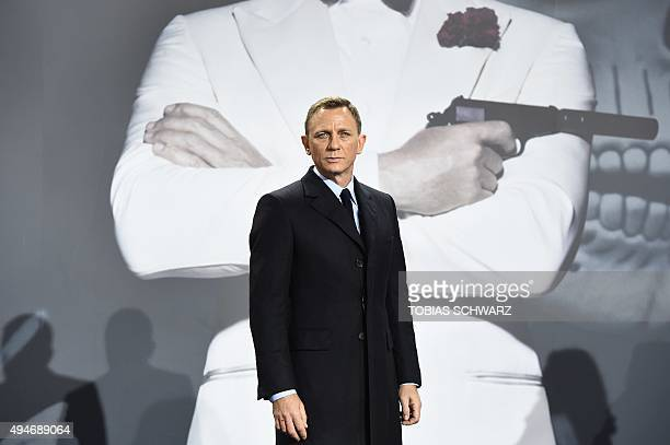 British actor Daniel Craig poses for photographers at a photocall for the new James Bond film 'Spectre' on October 28, 2015 in Berlin. AFP PHOTO /...