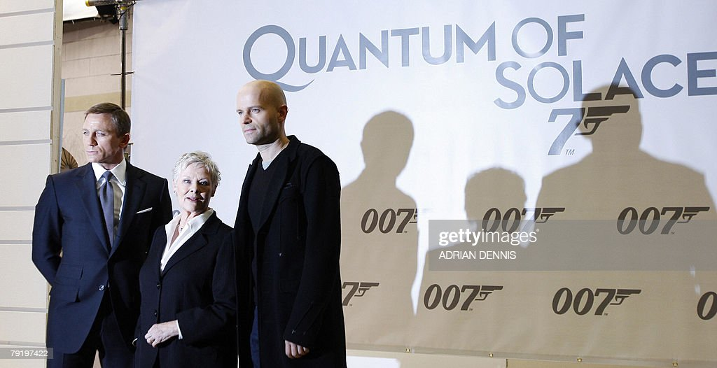 British actor Daniel Craig (L) poses with British actress Dame Judi Dench (C) and Director Marc Forster (R) during a photocall for the latest James Bond movie 'Quantum of Solace' to celebrate the start of production at Pinewood Studios in Iver Heath, Buckinghamshire, 24 January 2008. Eon productions and Sony Pictures are producing the 22nd James Bond adventure film where Bond is on a mission that leads him to Austria, Italy and South America .