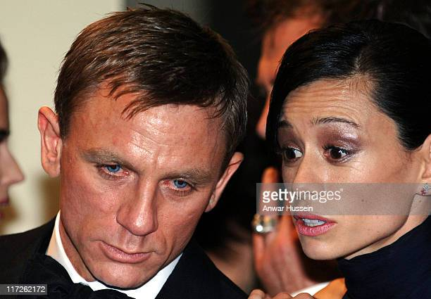 British actor Daniel Craig the new James Bond whispers to Satsuki Mitchell at the Royal Premiere for the 21st Bond film Casino Royale at the Odeon...