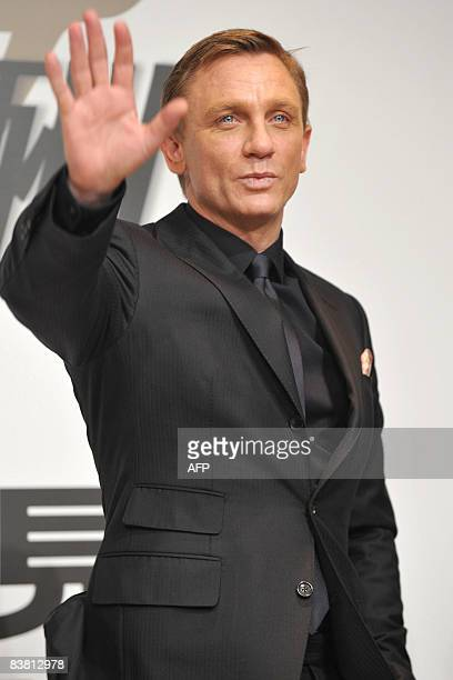 British actor Daniel Craig waves during a photo session after a news conference to promote the latest James Bond movie 'Quantum of Solace' in Tokyo...