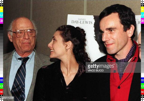 British actor Daniel DayLewis poses for photos with his wife Rebecca and her father playwright Arthur Miller at the premiere of 'The Crucible' 20...