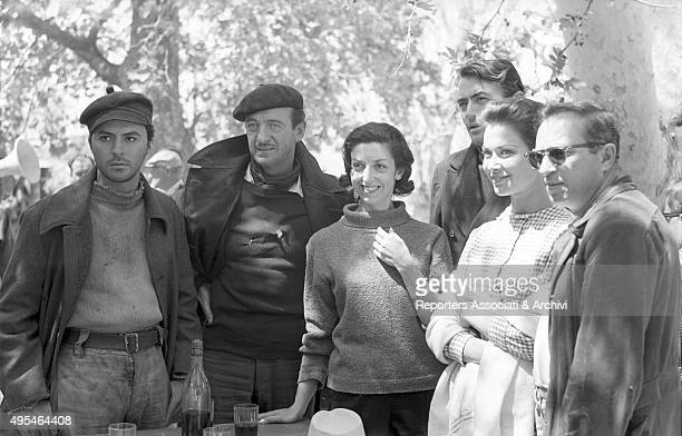 British actor David Niven American actor Gregory Peck British actress Gia Scala and British director J Lee Thompson posing on the set of the film The...