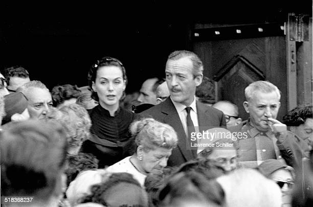 British actor David Niven and his wife Swedish model Hjordis Tersmeden a memorial service for producer Mike Todd at Temple Israel of Hollywood Los...