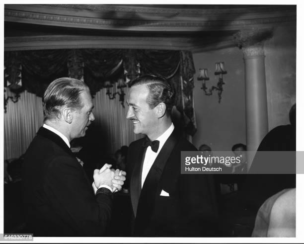 British actor David Niven with American actor Douglas Fairbanks at the Cafe de Paris, London, 1954.
