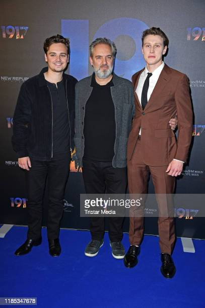 British actor DeanCharles Chapman British director Sam Mendes and British actor George MacKay attend a photocall of the movie '1917' at UCI Luxe...