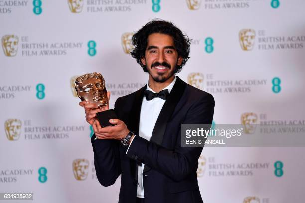 TOPSHOT British actor Dev Patel poses with the award for a Supporting Actor for his work on the film 'Lion' at the BAFTA British Academy Film Awards...