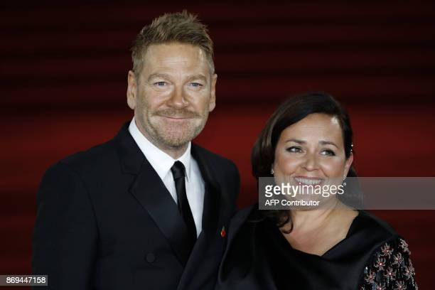 British actor, director, producer Kenneth Branagh poses with his wife Lindsay Brunnock upon arrival to attend the world premiere of the film 'Murder...