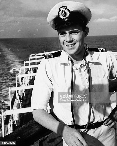 British actor Dirk Bogarde on the set of the comedy film 'Doctor At Sea' in which he plays medical officer Dr Simon Sparrow 1955