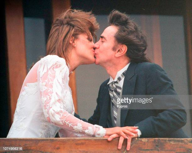British actor Dudley Moore kisses his new bride Nicole Rothschild at their wedding on April 16 1994 at Dudley Moore's Home 5505 Ocean Front Walk in...