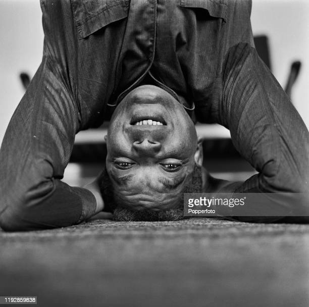 British actor Earl Cameron posed standing on his head in June 1967