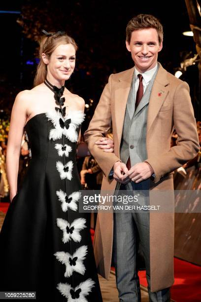 British actor Eddie Redmayne and his wife Hannah Bagshawe arrive for the premier of the fantasy film 'Fantastic Beasts The Crimes of Grindelwald' in...