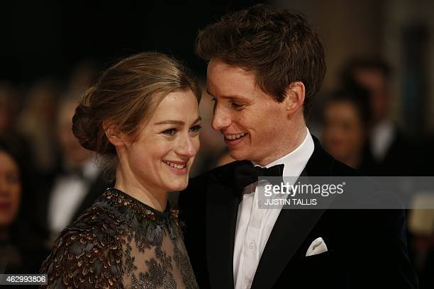 British actor Eddie Redmayne and wife Hannah Bagshawe pose on the red carpet for the BAFTA British Academy Film Awards at the Royal Opera House in...