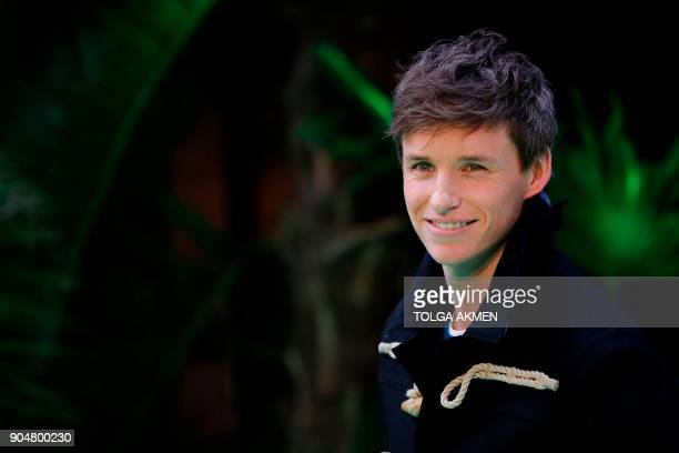 British actor Eddie Redmayne poses on the carpet arriving to attend the world premiere of the film Early Man in London on January 14 2018 / AFP PHOTO...