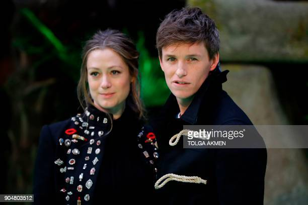 British actor Eddie Redmayne poses with his wife Hannah Bagshawe on the carpet arriving to attend the world premiere of the film Early Man in London...
