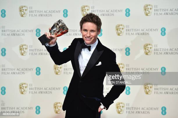 British actor Eddie Redmayne poses with the award for a leading actor for his work on the film The Theory of Everything at the BAFTA British Academy...