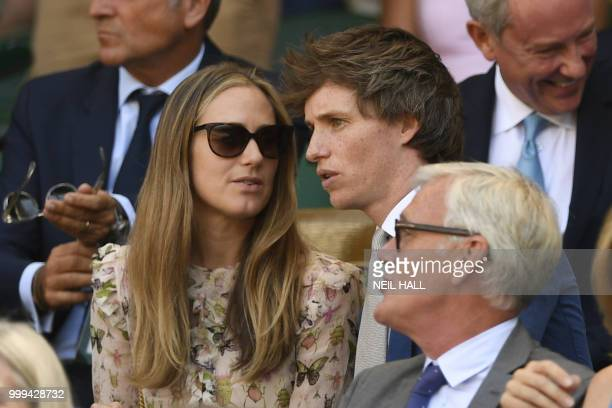 British actor Eddie Redmayne speaks with his wife Hannah in the Royal Box before South Africa's Kevin Anderson plays Serbia's Novak Djokovic in their...