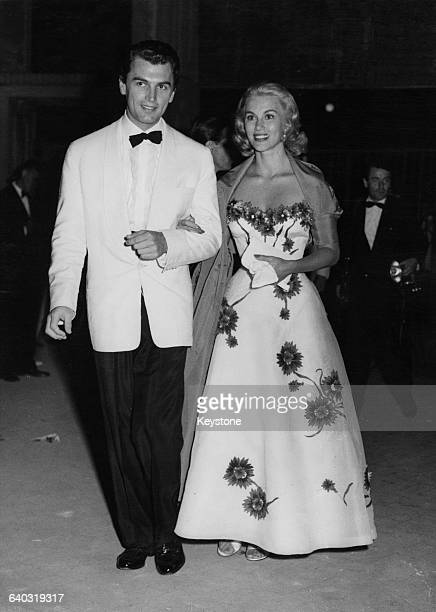 British actor Edmund Purdom escorts actress Linda Christian the wife of screen idol Tyrone Power to the Kentucky Ball at the Luna Linda during the...