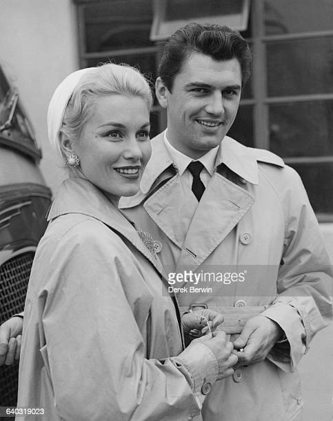 British actor Edmund Purdom with actress Linda Christian the exwife of screen idol Tyrone Power at London Airport UK 9th August 1956 The couple were...