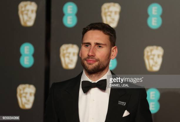 British actor Edward Holcroft poses on the red carpet upon arrival at the BAFTA British Academy Film Awards at the Royal Albert Hall in London on...