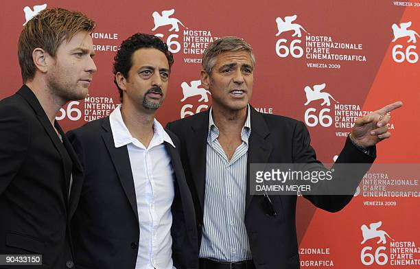 """British actor Ewan McGregor, US director Grant Heslov and US actor George Clooney pose during the photocall of """"The men who stare at goats"""" at the..."""