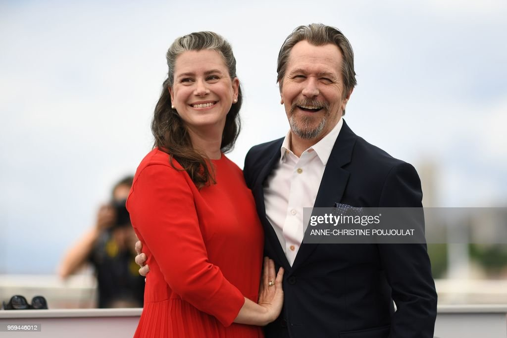 British actor Gary Oldman (R) and his wife Gisele Schmidt pose on May 17, 2018 during a 'Rendez-Vous with Gary Oldman' at the 71st edition of the Cannes Film Festival in Cannes, southern France.