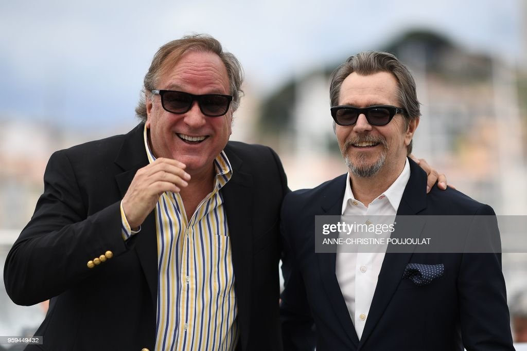 British actor Gary Oldman (R) and US producer Douglas Urbanski pose on May 17, 2018 during a 'Rendez-Vous with Gary Oldman' at the 71st edition of the Cannes Film Festival in Cannes, southern France.
