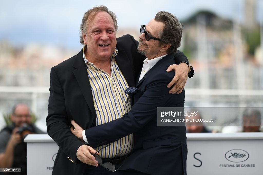 TOPSHOT - British actor Gary Oldman (R) and US producer Douglas Urbanski pose on May 17, 2018 during a 'Rendez-Vous with Gary Oldman' at the 71st edition of the Cannes Film Festival in Cannes, southern France.