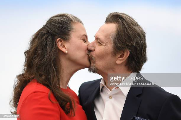 British actor Gary Oldman kisses his wife Gisele Schmidt on May 17 2018 during a 'RendezVous with Gary Oldman' at the 71st edition of the Cannes Film...