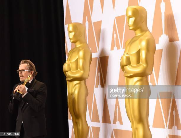 British actor Gary Oldman poses in the press room with the Oscar for Best Actor in Darkest Hour during the 90th Annual Academy Awards on March 4 in...