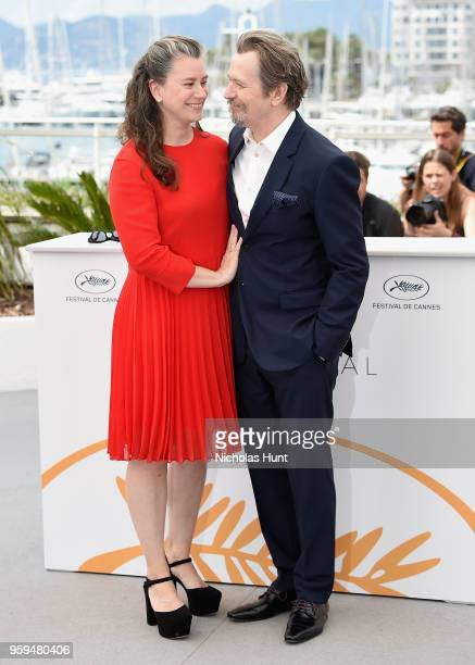 British actor Gary Oldman poses with his wife Gisele Schmidt at the RendezVous with Gary Oldman Photocall during the 71st annual Cannes Film Festival...