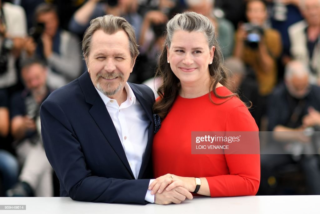 British actor Gary Oldman (L) poses with his wife Gisele Schmidt on May 17, 2018 during a 'Rendez-Vous with Gary Oldman' at the 71st edition of the Cannes Film Festival in Cannes, southern France.