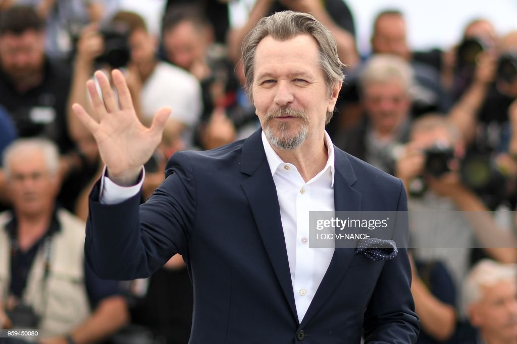 TOPSHOT - British actor Gary Oldman waves on May 17, 2018 during a 'Rendez-Vous with Gary Oldman' at the 71st edition of the Cannes Film Festival in Cannes, southern France.