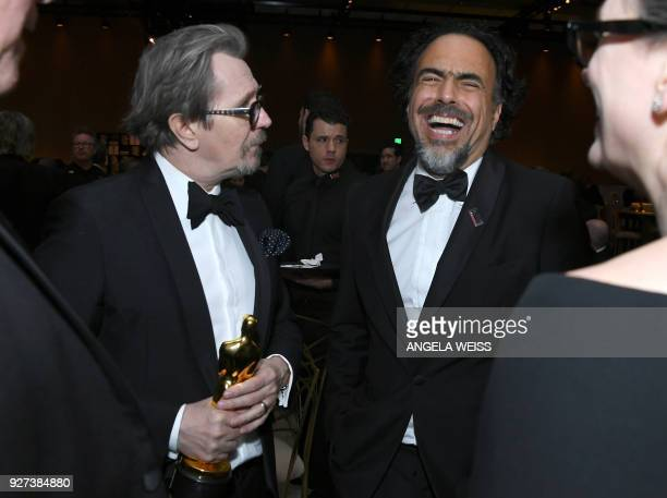 British actor Gary Oldman winner of Best Actor for Darkest Hour holds an Oscar beside Mexican director Alejandro G Inarritu during the 90th Annual...
