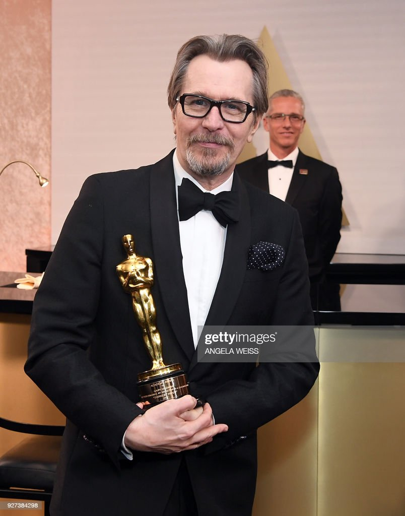 British actor Gary Oldman, winner of Best Actor for Darkest Hour poses in the with the Oscar during the 90th Annual Academy Awards on March 4, 2018, in Hollywood, California. /