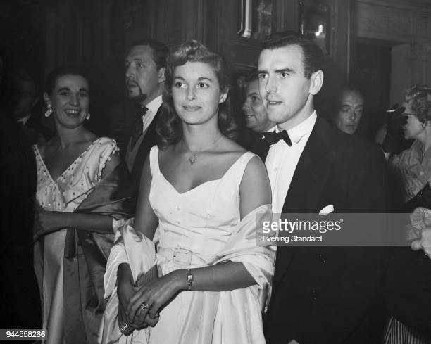 British actor George Cole and his wife Eileen Moore arrive at the Garrick Theatre in London 7th September 1955