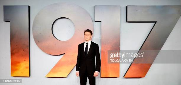"""British actor George MacKay poses on the red carpet as he arrives to attend the World premiere and Royal Film Performance of the film """"1917"""" in..."""