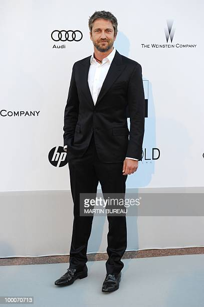British actor Gerard Butler poses while arriving at amfAR's Cinema Against Aids 2010 benefit gala on May 20 2010 in Antibes southeastern France AFP...