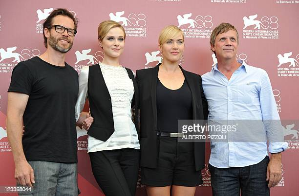 """British actor Guy Pierce, US actress Evan Rachel Wood, actress Kate Winslet and US director Todd Haynes pose during the photocall of """"Mildred Pierce""""..."""