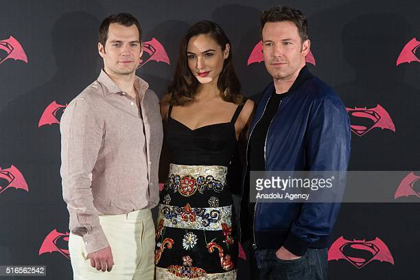 British actor Henry Cavill American actor Ben Affleck and Israeli actress Gal Gadot pose for pictures during the Batman v Superman Movie photocall at...