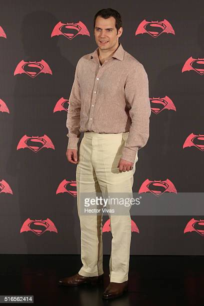 British actor Henry Cavill poses for pictures during the Batman v Superman Movie photocall at Hotel St Regis on March 19 2016 in Mexico City Mexico